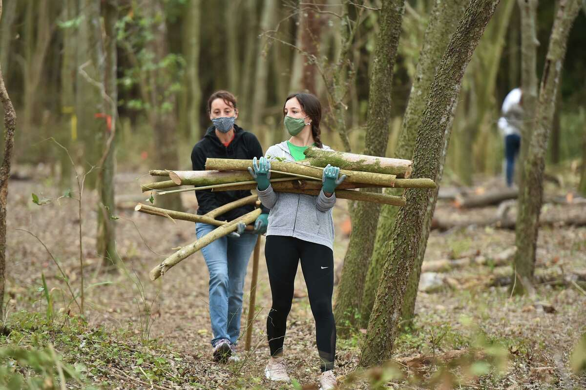 Hannah and Marlene Cullum clear ligustrum limbs during a workshop for residents to connect with nature and learn more about environmental conservation. The workshop took place at the Headwaters at Incarnate Word Saturday morning.