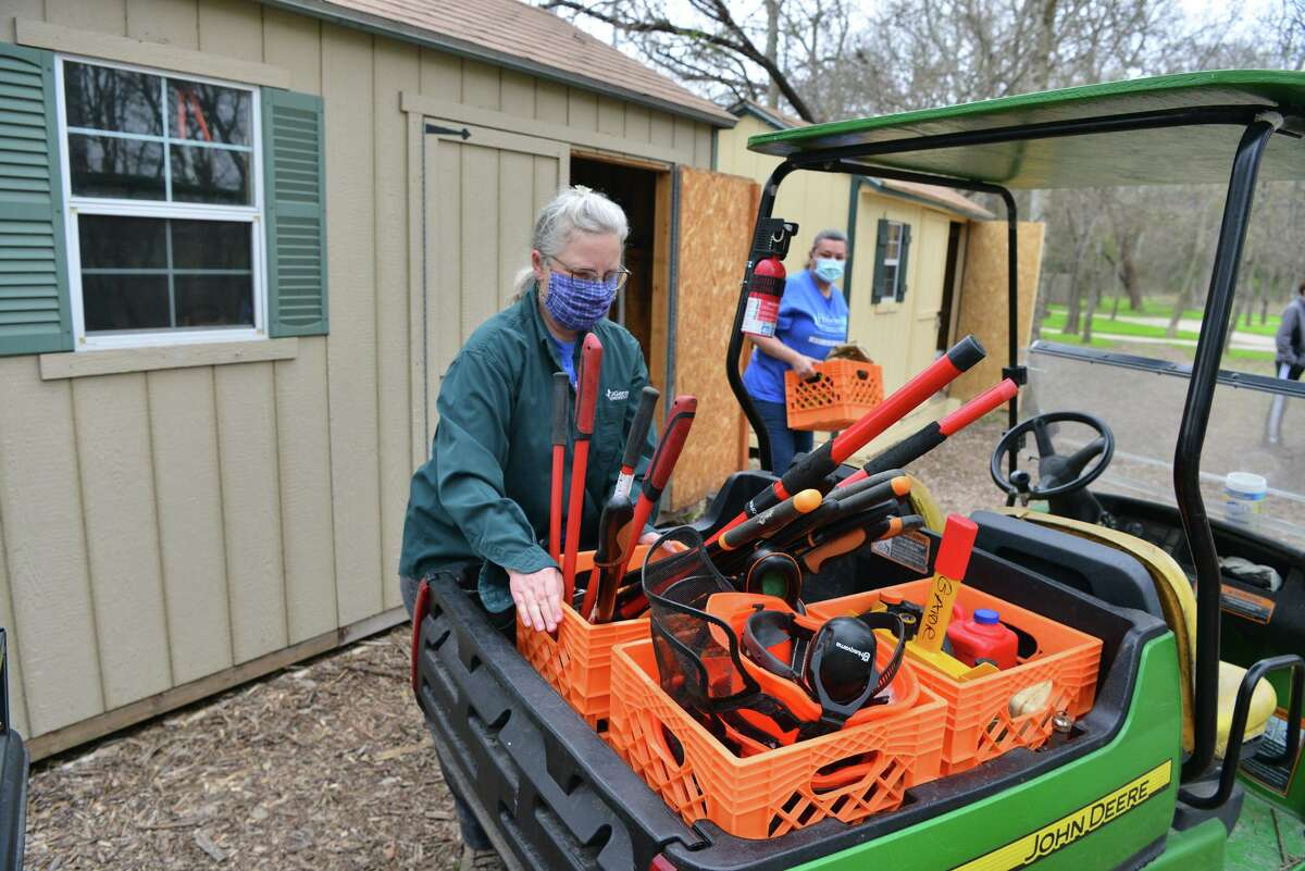 Rowena Ochiagha (left) and Pamela Ball loads tools and supplies during a workshop for residents to connect with nature and learn more about environmental conservation. The workshop took place at the Headwaters at Incarnate Word Saturday morning.