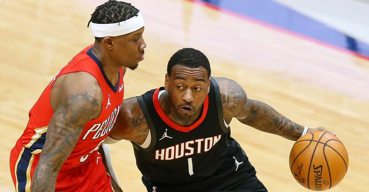 John Wall #1 of the Houston Rockets drives against Eric Bledsoe #5 of the New Orleans Pelicans during the first half at the Smoothie King Center on January 30, 2021 in New Orleans, Louisiana.(Photo by Jonathan Bachman/Getty Images)
