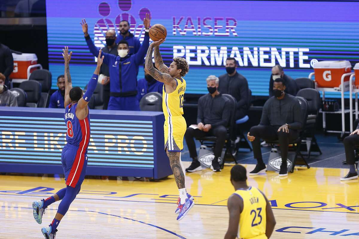Golden State Warriors guard Kelly Oubre Jr. (12) scores a three-point field goal and the first points of the game against Detroit Pistons guard Wayne Ellington (8) in the first period of an NBA game at Chase Center on Saturday, Jan. 30, 2021, in San Francisco, Calif.