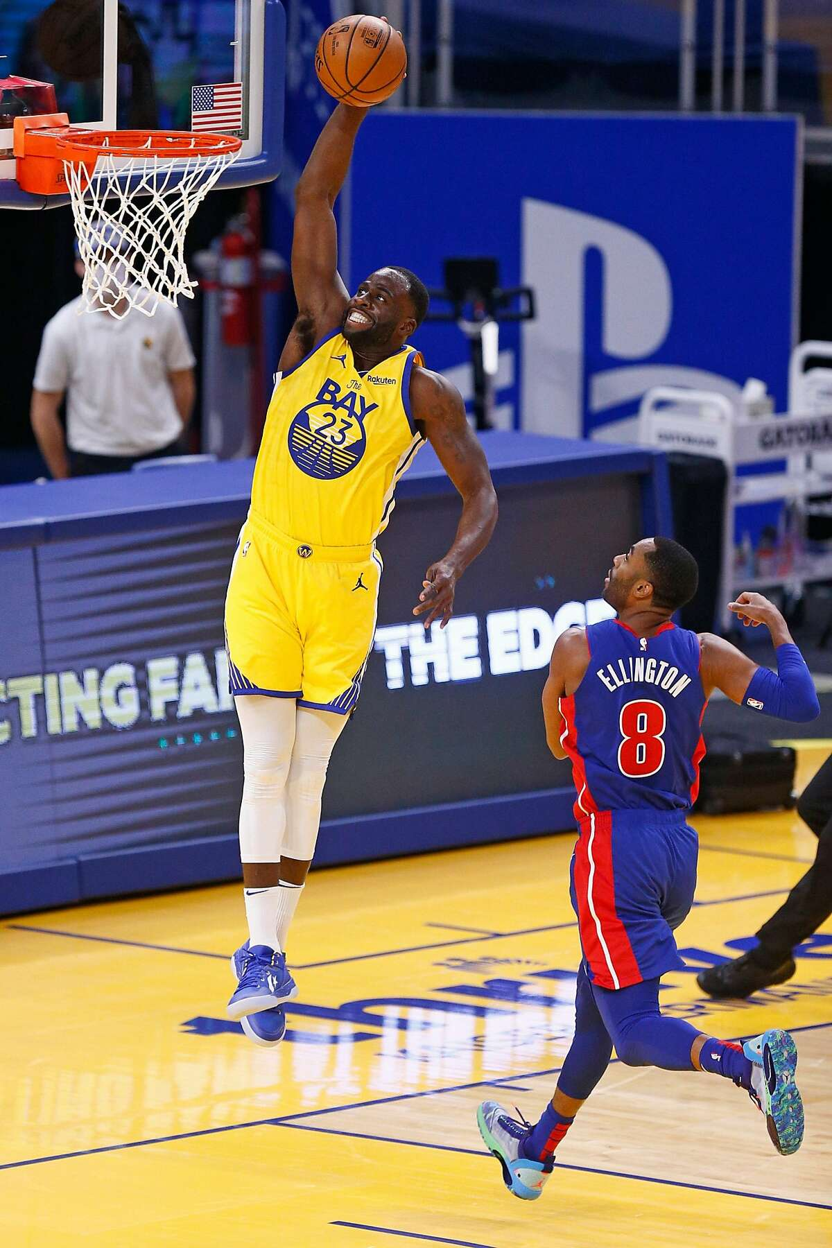 Golden State Warriors forward Draymond Green (23) dunks against Detroit Pistons guard Wayne Ellington (8) in the first period of an NBA game at Chase Center on Saturday, Jan. 30, 2021, in San Francisco, Calif.