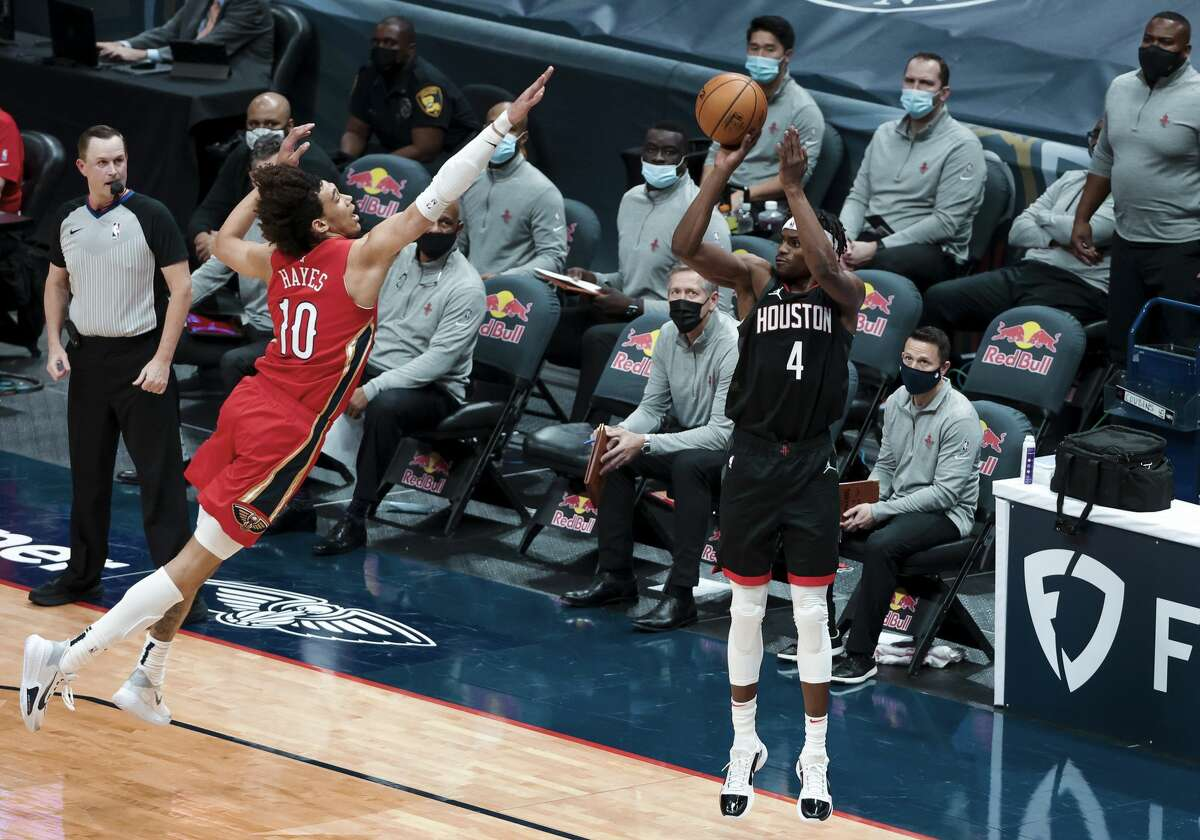 Houston Rockets forward Danuel House Jr. (4) shoots over New Orleans Pelicans center Jaxson Hayes (10) in the first quarter of an NBA basketball game in New Orleans, Saturday, Jan. 30, 2021. (AP Photo/Derick Hingle)