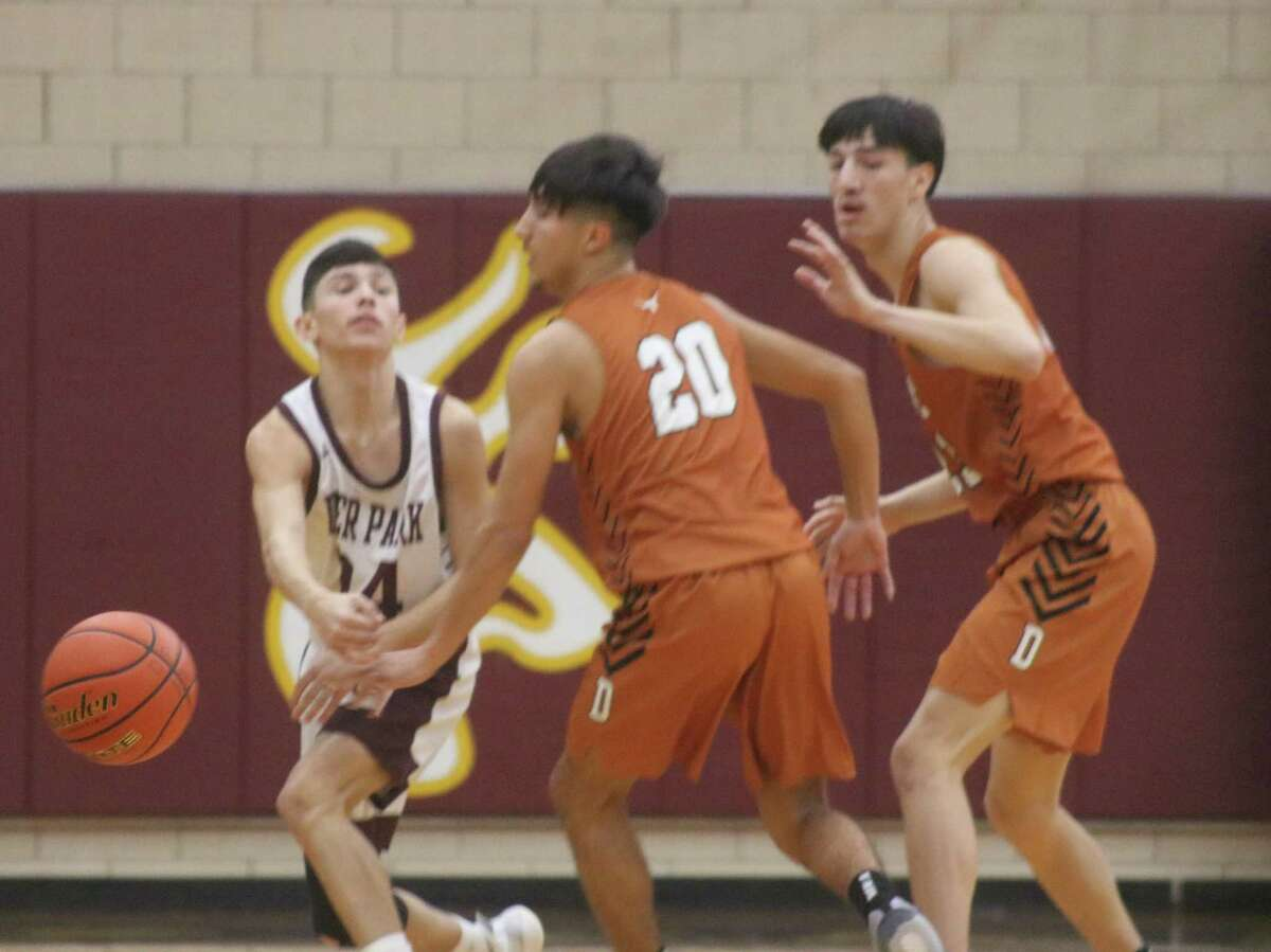 Deer Park's Andrew Aguilar finds himself confronted by the Dobie duo of Zachary Wallace and Damien Garcia as the Longhorns employ a pressure defense to slow down the Deer.