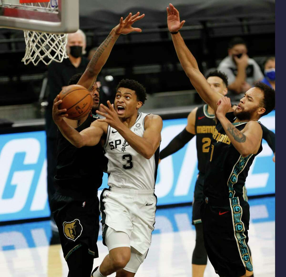 Keldon Johnson #3 of the San Antonio Spurs #3 drives past Kyle Anderson #1 #3 of the Memphis Grizzlies Grizzlies v Spurs at AT&T Center on Saturday, January 30,2021