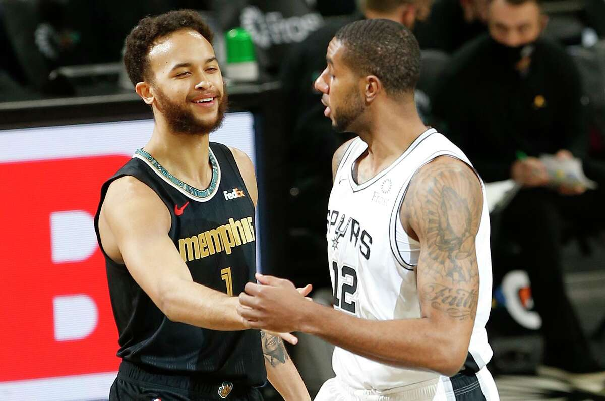 Kyle Anderson, left, who played for the Spurs from 2014-18, entered Monday night's game averaging 12.8 points, 7.1 rebounds and 3.9 assists - all career highs - for Memphis.