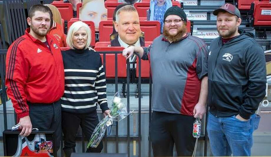 SIUE senior wrestlers Tommy Helton with his family on Senior Day inside First Community Arena in Edwardsville. Photo: SIUE Athletics