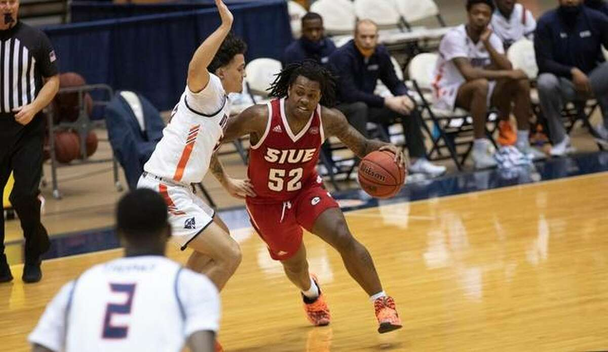 SIUE guard Iziah James shields the ball away from a UT Martin defender during Saturday's road game.