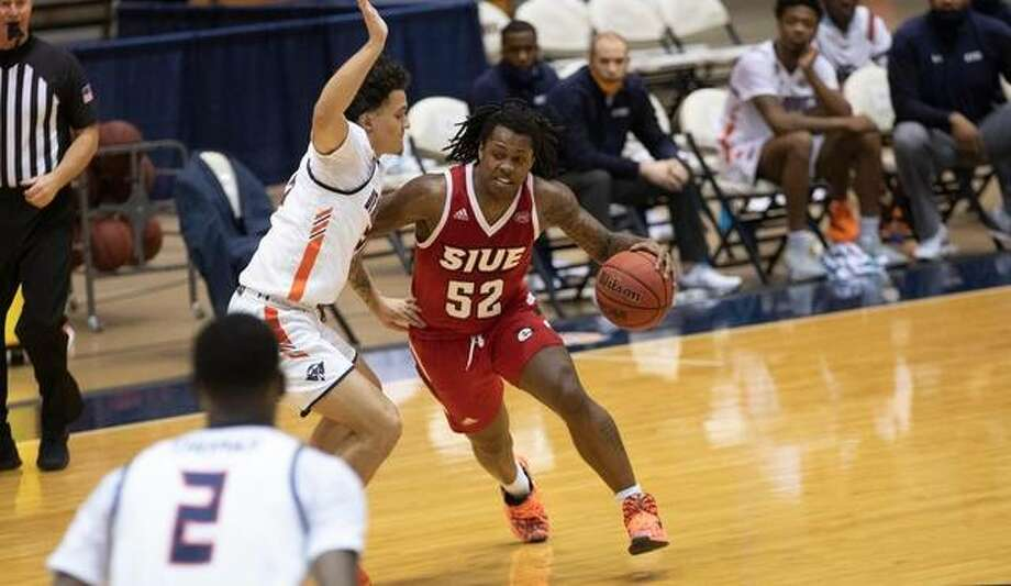 SIUE guard Iziah James shields the ball away from a UT Martin defender during Saturday's road game. Photo: SIUE Athletics