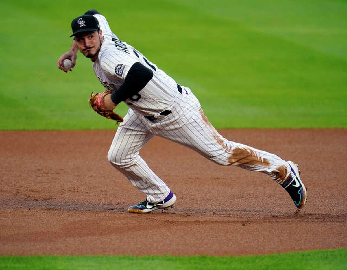 In this Sept. 11, 2020, file photo, Colorado Rockies third baseman Nolan Arenado throws to first during the first inning of a baseball game against the Los Angeles Angels in Denver.