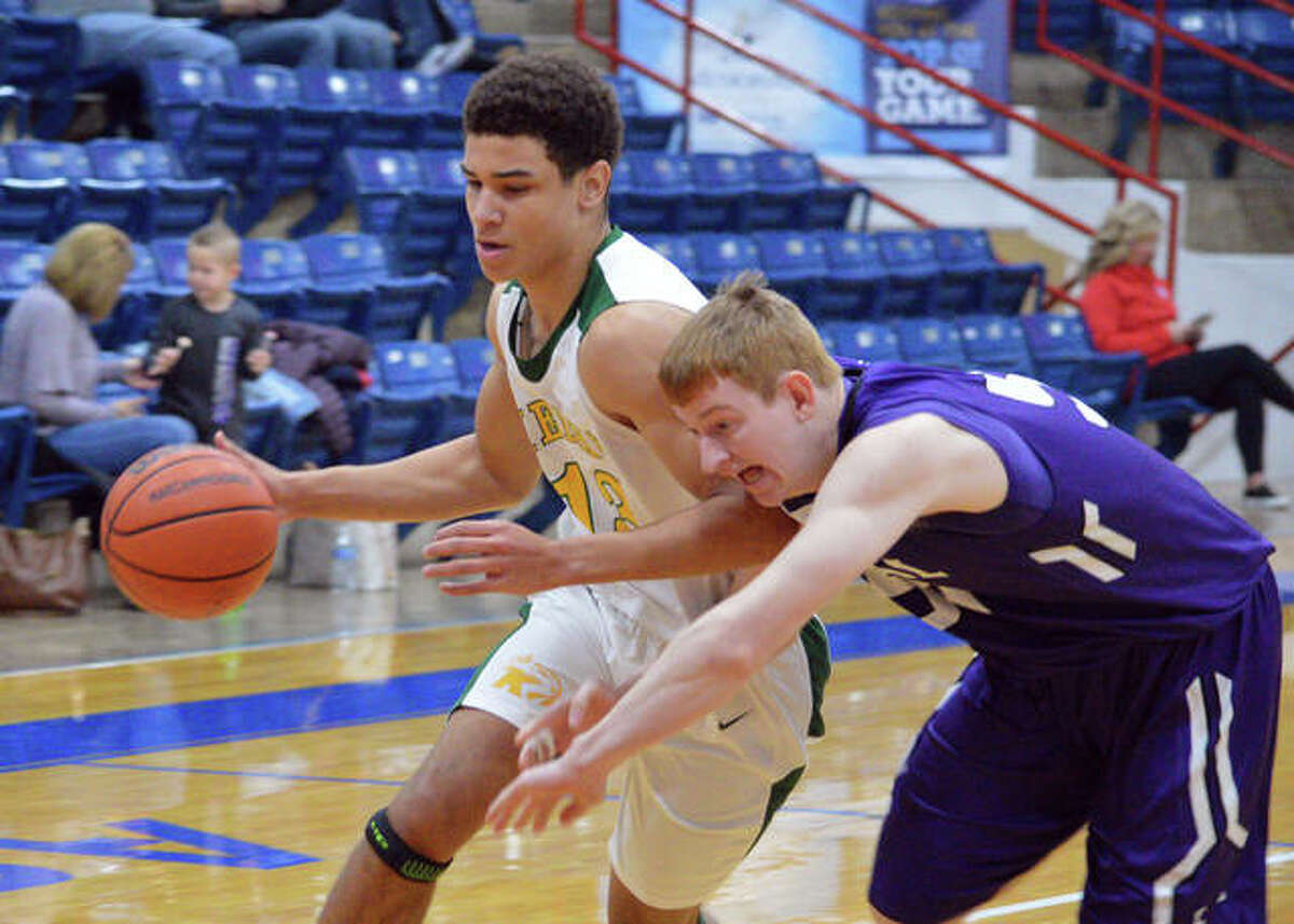 Metro-East Lutheran's AJ Smith, left, dribbles past a Breese Central defender a game at the Nashville Invitational.