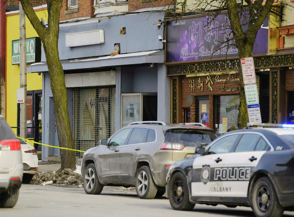 A view of the scene at 211 Central Ave. in Albany, N.Y., where Albany Police said that three women and two men were shot late Saturday night. One woman died. (Paul Buckowski/Times Union)