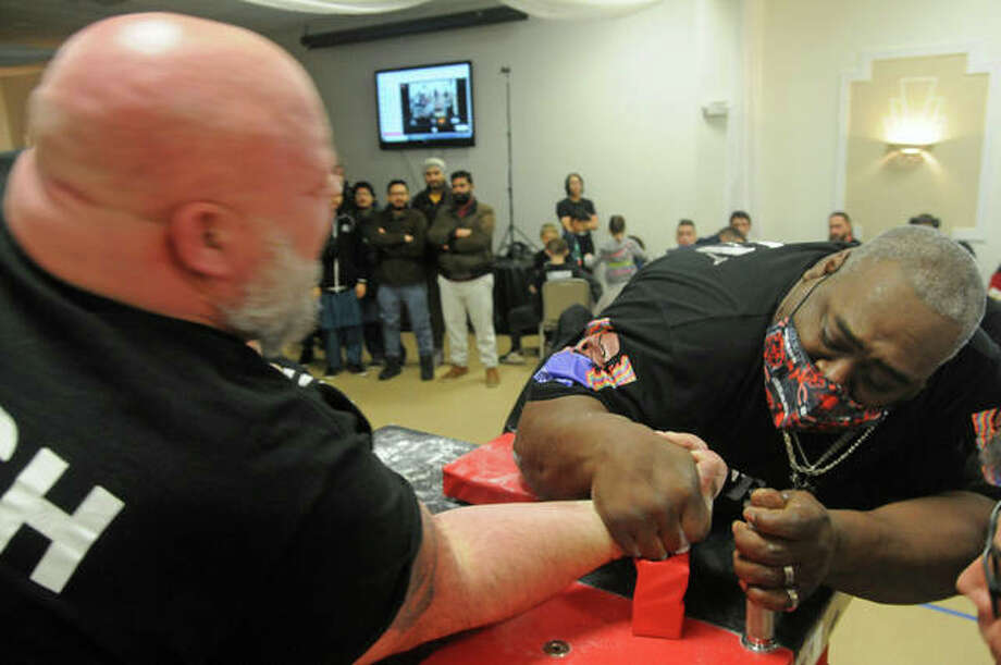 A competitor pins his opponent to win during Saturday's USAA Illinois State Armwrestling Championships in Pocahontas.