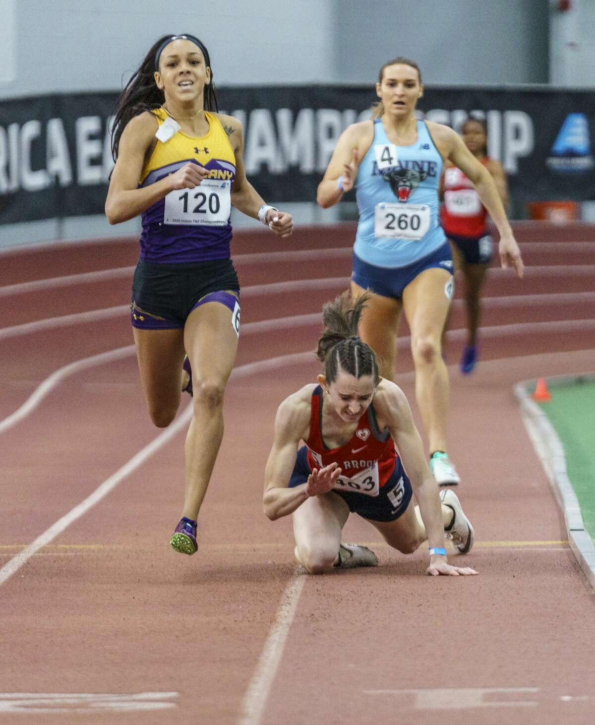 Asia Jinks, UAlbany track and field star, during the 400m final at the 2020 America East Indoor Championships.  The runner who falls is Stony Brook's Amanda Stead, who was the favorite heading into the championship meet and the top seed in the final. (America East Conference)