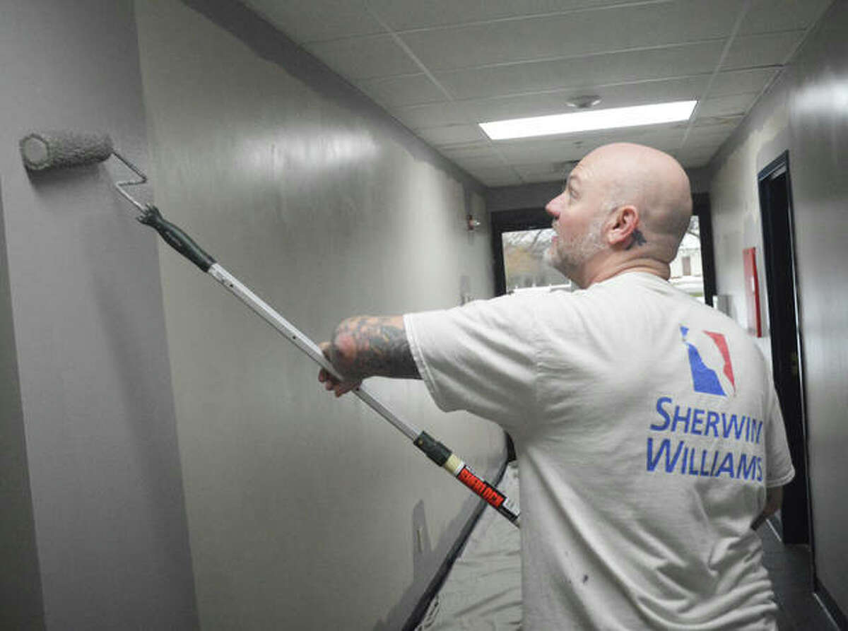 Travis Gillig of Signature Custom Painting in Edwardsville was among four professional painters who donated their time on Saturday morning to paint the lounge and entrance hall at Edwardsville American Legion Post 199.