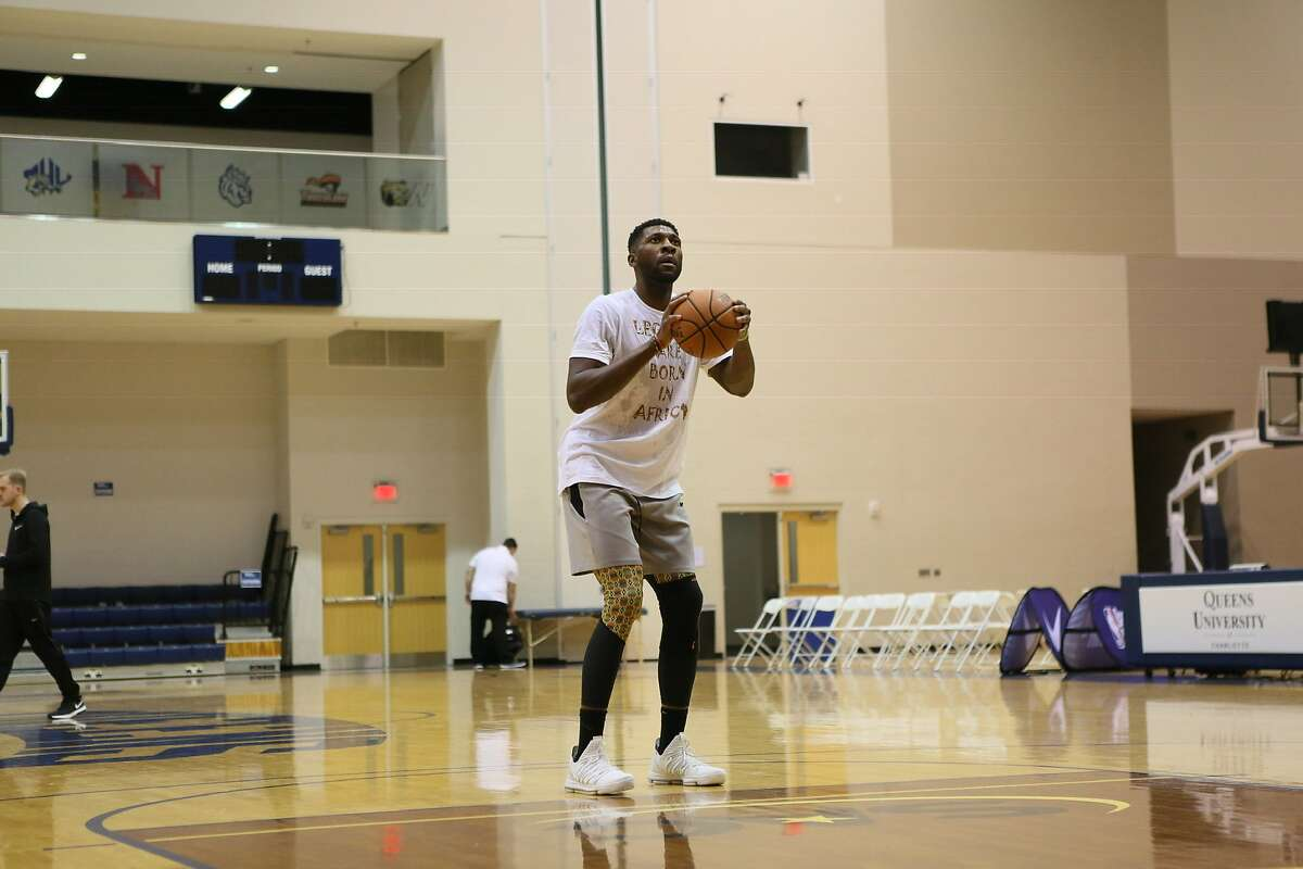 Festus Ezeli, a favorite of coach Steve Kerr, is finally healthy at 31. He has a Vanderbilt degree in economics for life after sports, but his mother's wisdom keeps his focus on one mountain at a time.
