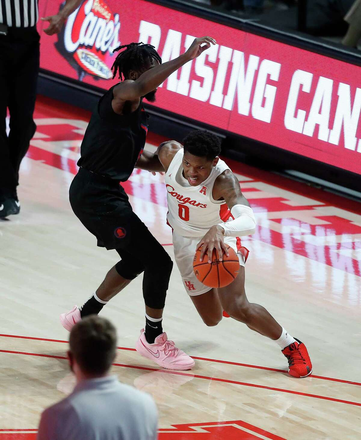 Houston Cougars guard Marcus Sasser (0) works against Southern Methodist Mustangs guard Emmanuel Bandoumel (5) during the first half of an NCAA men's basketball game at the Fertitta Center, in Houston, Sunday, Jan. 31, 2021.