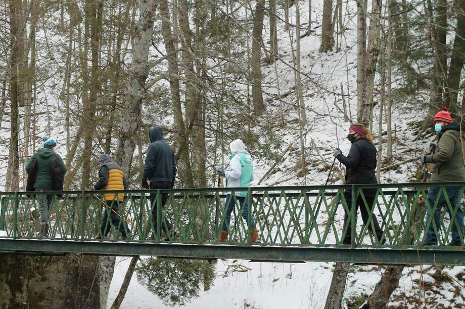 Spirit of the Woods Conservation Club member Devin Wegner leads hikers on a guidedsnowshoe walk on the club property in Brethren on Saturday. (Kyle Kotecki/News Advocate)