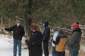 """Spirit of the Woods Conservation Club board president Gene Lagerquist leads a guided hike on """"Mickey's Trail"""" on the club property in Brethren on Saturday. (Kyle Kotecki/News Advocate)"""