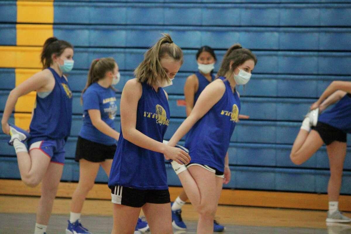 Evart girls basketball players go through conditioning work on Friday. (Pioneer photo/John Raffel)