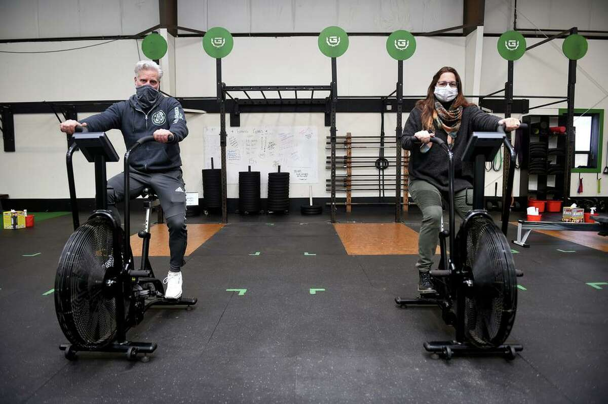 Clint Zeidenberg (left), owner of the Guilford Athletic Center, and Dr. Hannah Jurewicz are photographed at the athletic center in Guilford on January 21, 2021.