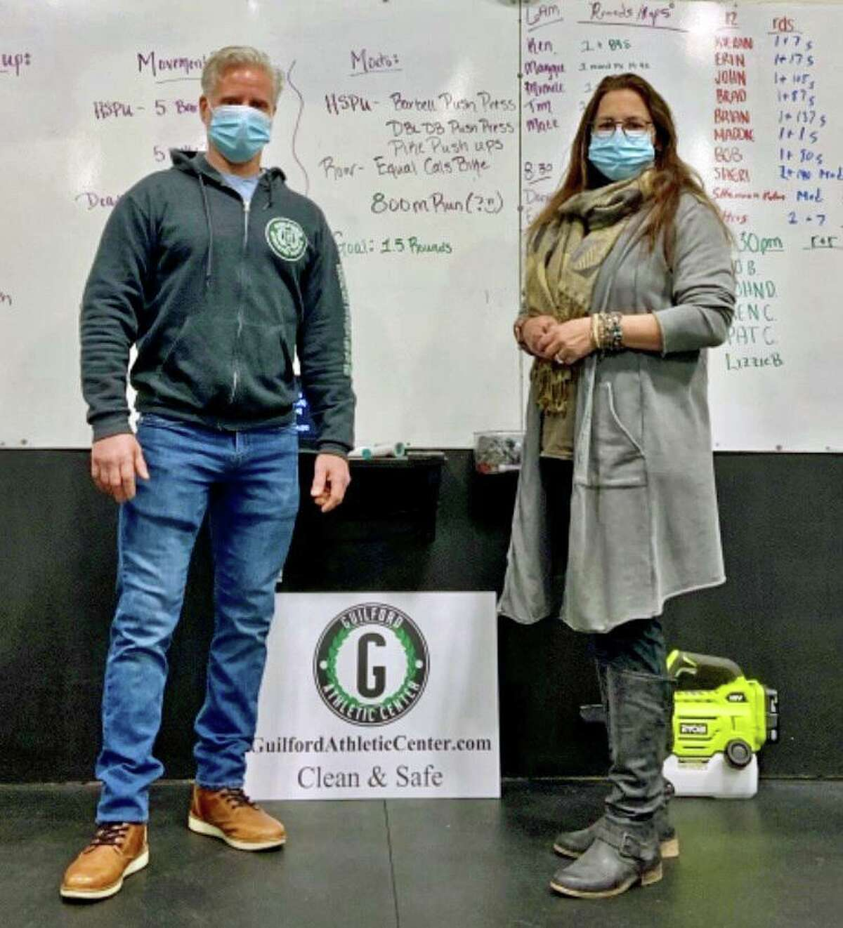 Clint Zeidenberg and Hannah Jurewicz, a Guilford psychologist, at the Guilford Athletic Center, who created the unique program, which comprises a one-hour workout followed by a recovery meeting.