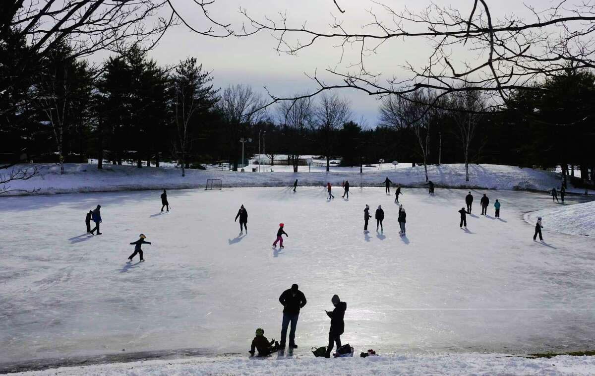 Children and adults skate at Elm Avenue Park on Sunday, Jan. 31, 2021, in Bethlehem, N.Y. A winter storm warning has been issued for the Capital Region for Monday, Feb. 1, 2021. (Paul Buckowski/Times Union)