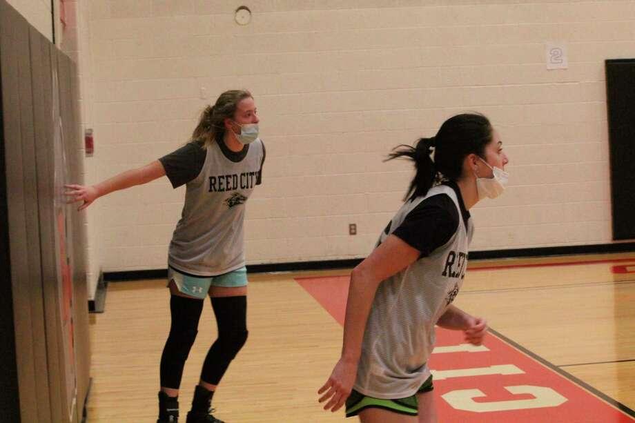 Reed City girls partake in conditioning drills on Wednesday. (Pioneer photo/John Raffel)