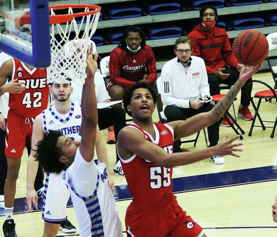 SIUE's Lamar Wright (55) puts up a left-handed shot to score over an Eastern Illinois defender in the Cougars' OVC victory Tuesday night at Lantz Arena in Charleston. Photo: Greg Shashack / The Telegraph