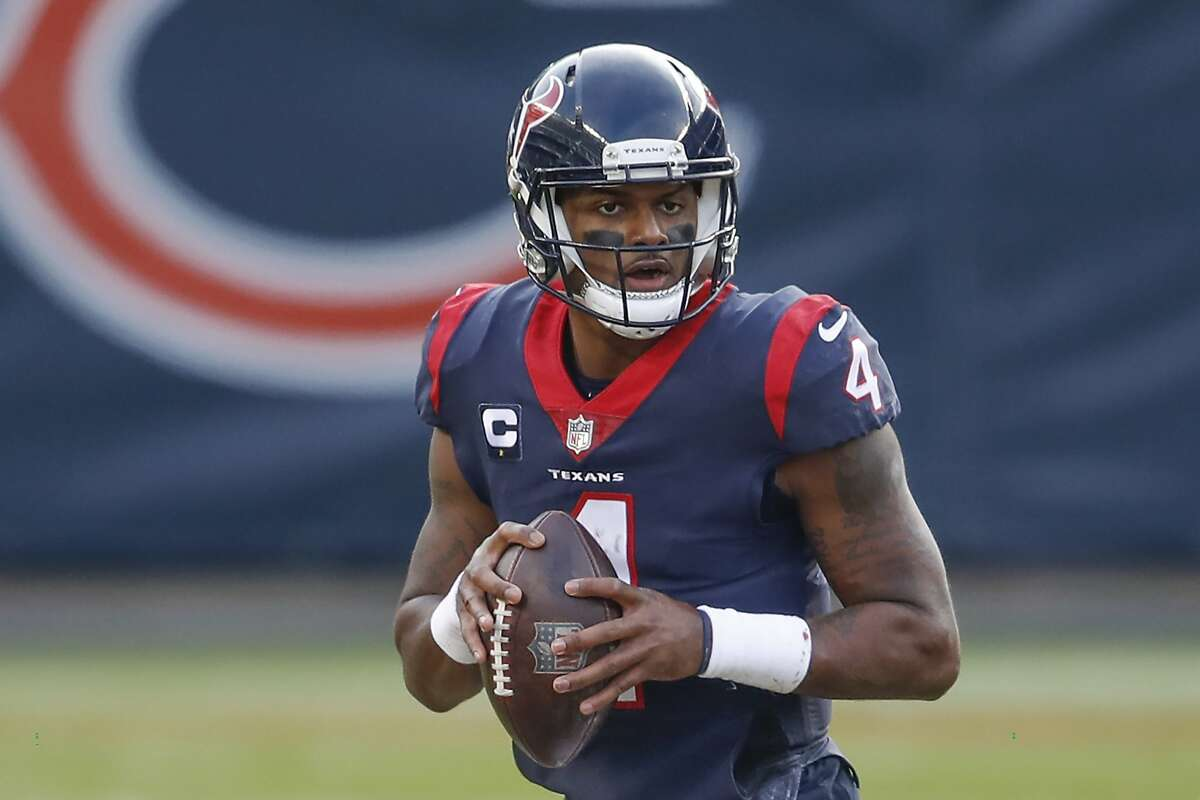 Houston Texans quarterback Deshaun Watson (4) looks to pass the ball during the second half of an NFL football game against the Chicago Bears, Sunday, Dec. 13, 2020, in Chicago.