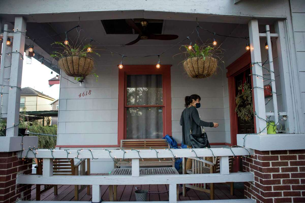 Houston Chronicle business reporter Rebecca Schuetz walks to her front door to her Eastwood area home Thursday, Jan. 28, 2021 in Houston. With interest rates at historic lows, Schuetz is thinking about refinancing her home.