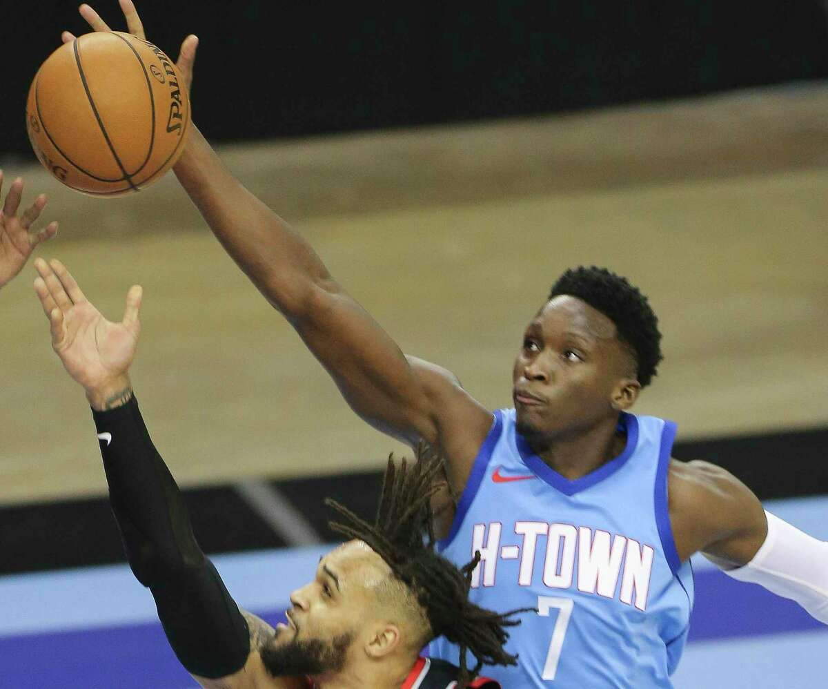 Rockets guard Victor Oladipo (7) blocks the shot of Trail Blazers guard Gary Trent Jr. during Thursday's 104-101 victory, the fourth in what is now a five-game Houston winning streak.
