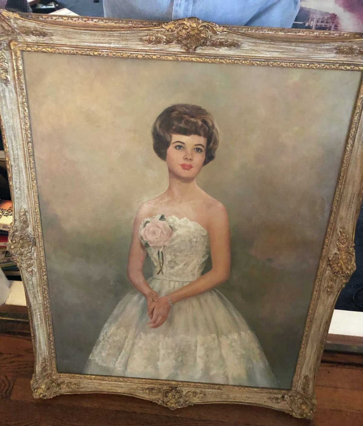 Sam Gorman sold this painted portrait of his mother, Cheri Gorman, at an estate sale and regretted it soon after. He is trying to get it back.