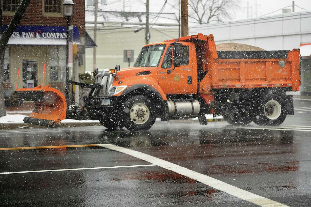 A Fairfield Public Works plow truck during the snow on the Post Road in Fairfield, Conn. on Wednesday, March 21, 2018.