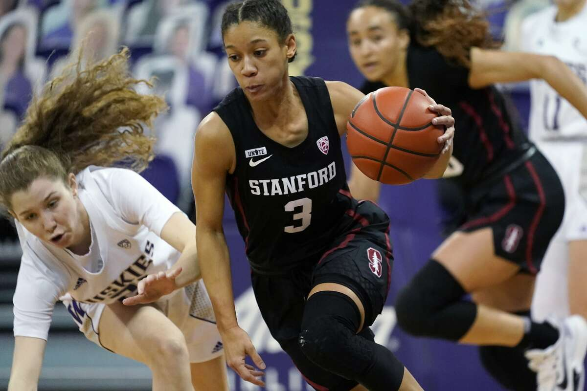 Stanford's Anna Wilson, who had five rebounds and three steals, drives past Washington's Jess Finney in the first half.