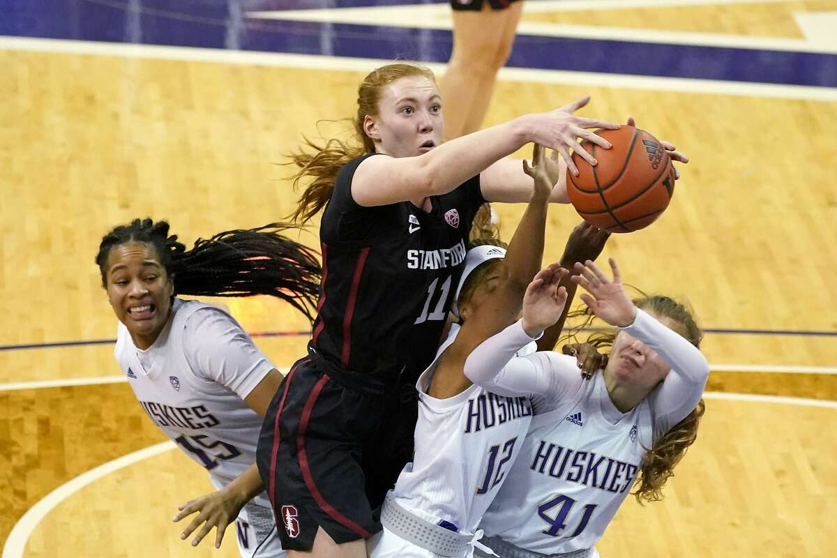 Stanford's Ashten Prechtel reaches for a rebound over Washington's Nia Lowery (15), Carol Chikusa (12), and Callie Lind in the second half in Seattle.