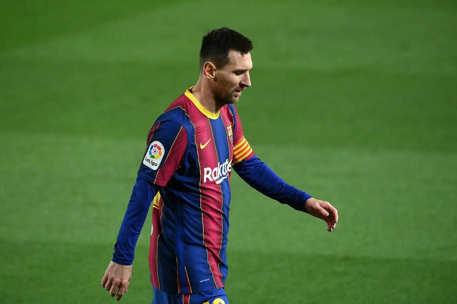 Barcelona's Argentinian forward Lionel Messi reacts during the Spanish league football match FC Barcelona against Athletic Club Bilbao at the Camp Nou stadium in Barcelona on January 31, 2021. (Photo by LLUIS GENE / AFP) (Photo by LLUIS GENE/AFP via Getty Images) Photo: LLUIS GENE / AFP Via Getty Images