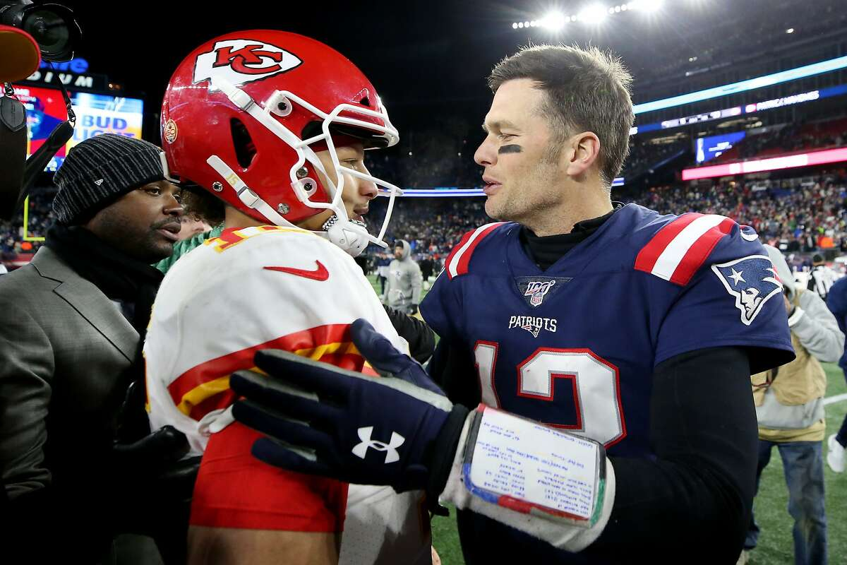 Tom Brady, right, of the New England Patriots talks with Patrick Mahomes of the Kansas City Chiefs after the Chiefs defeat the Patriots 23-16 at Gillette Stadium on Dec. 8, 2019, in Foxborough, Mass.