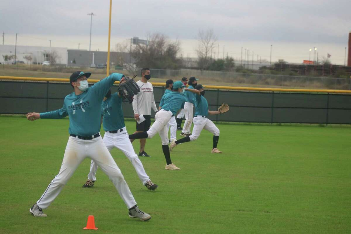 Mavs head coach Terry Garza watches a line of Maverick players practice a throwing routine during a recent practice.