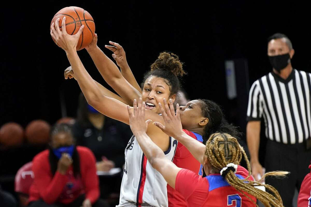 UConn's Olivia Nelson-Ododa, who had 10 points, is pressured by two DePaul players during the Huskies' win in Chicago.
