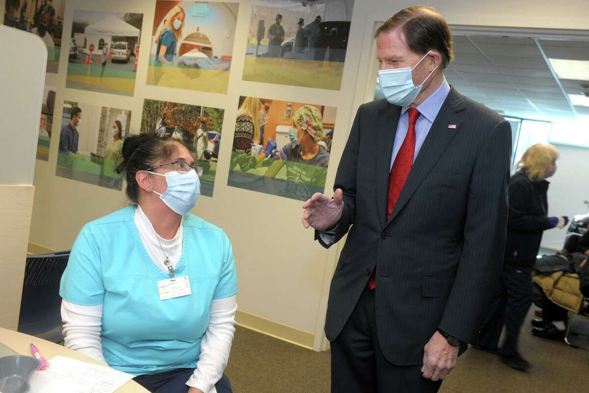 US Sen. Richard Blumenthal speaks with nurse Allison Federico during a tour of Griffin Hospital's vaccination clinic in Shelton, Conn. Jan. 29, 2021.