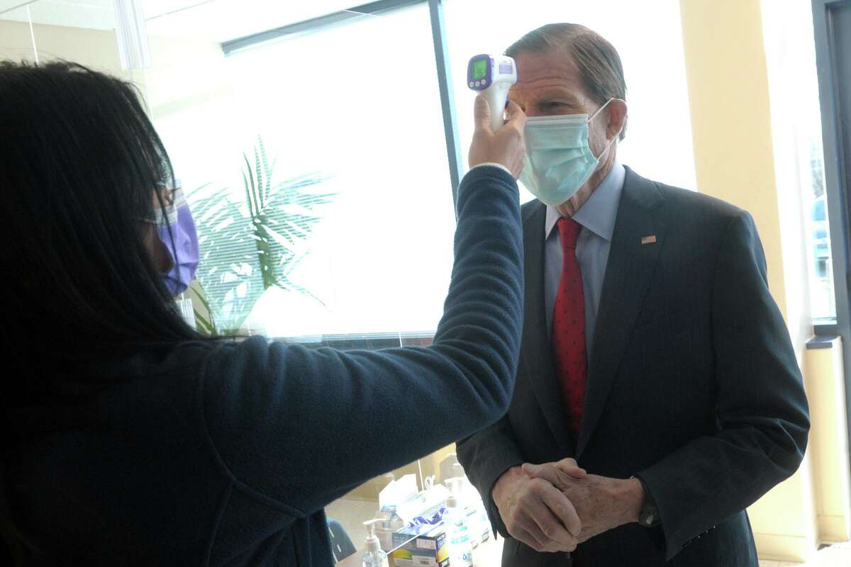 US Sen. Richard Blumenthal has his temperature checked as he arrives for a tour of Griffin Hospital's vaccination clinic in Shelton, Conn. Jan. 29, 2021.