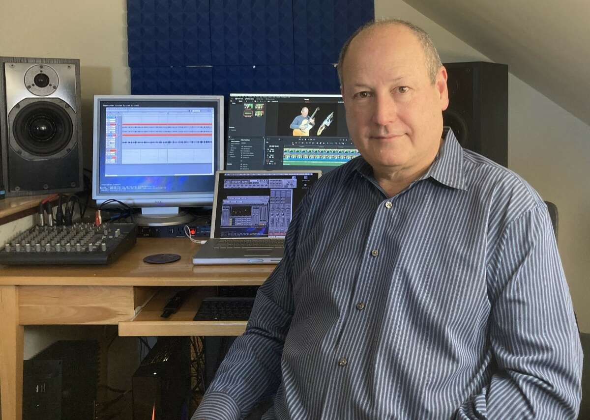 Mark Kleinhaut in front of the equipment he uses to process the videos for the CDJ project. (credit: Erika Aberg)