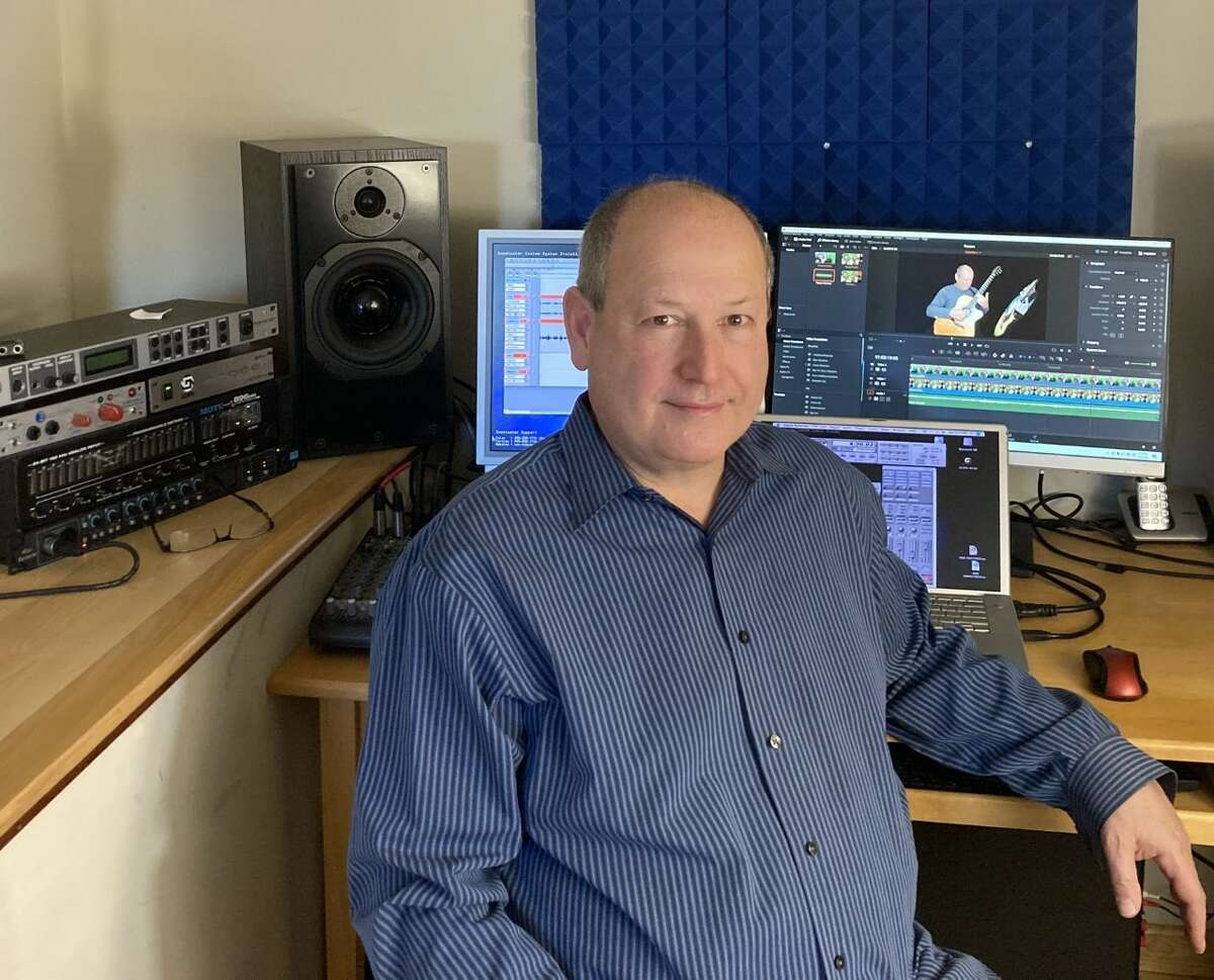 Mark Kleinhaut in front of the equipment he uses to process the videos for the CDJ project.(credit: Erika Aberg)