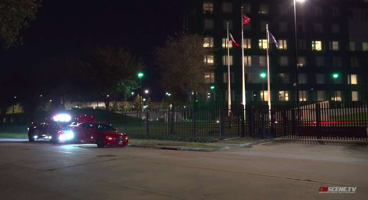 A red Dodge Charger involved in a pursuit was left at the front gates of the Houston FBI building at 1 Justice Park Drive on Sunday, Jan. 31. 2021.