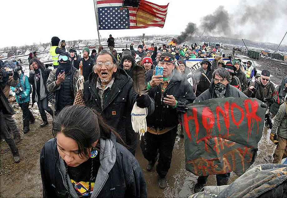 A crowd representing a majority of the remaining Dakota Access Pipeline protesters march near Cannon Ball, North Dakota, in 2017. After President Joe Biden revoked Keystone XL's presidential permit and shut down construction of the long-disputed pipeline that was to carry oil from Canada to Texas, opponents of other pipelines hope the projects they've been fighting would be next. Photo: Mike McCleary | Bismarck Tribune (AP)
