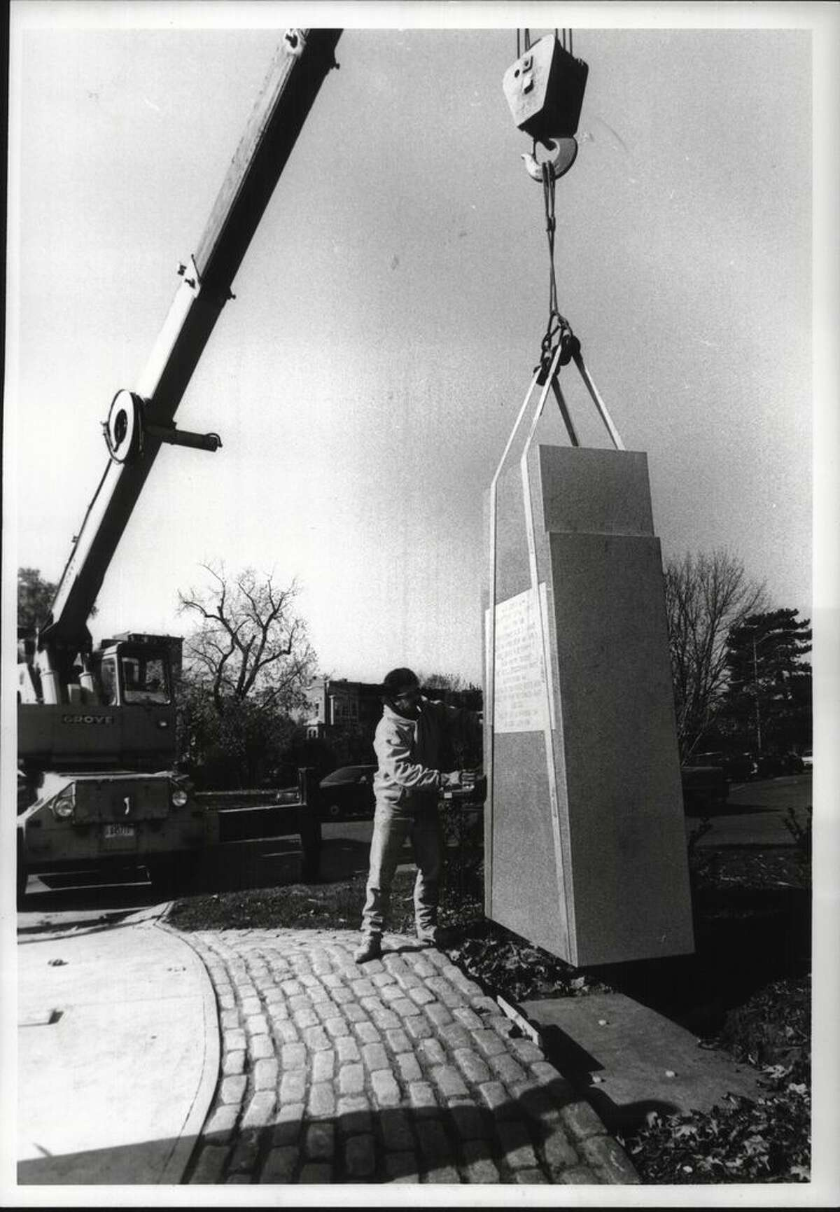 John Gadani, Albany Department of Public Works worker, guides a monument for Sgt. Henry Johnson into place in Washington Park on Oct. 30, 1991, at Willet Street and Madison Avenue. It was dedicated on Nov. 11 - Veterans Day. (Roberta Smith/Times Union)