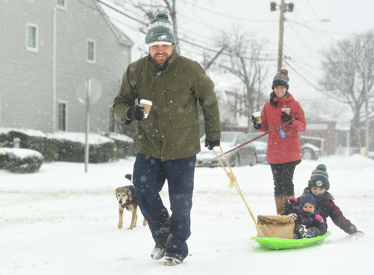 Stokes and Britton Carrigan, and their children Stokes, 6, and Elle, 1, don't let the snow prevent their morning walk for coffee and breakfast on Cove Avenue in Norwalk, Conn. on Monday, February 1, 2021. Potential power/internet outages One of the main reasons Connecticut school districts call for a snow day is the possibility of power and internet outages, which would eliminate the option of remote learning. This week, the Newtown school district planned for the first two days impacted by snow to be considered traditional snow days. The days affected by weather that follow will instead be remote learning days.