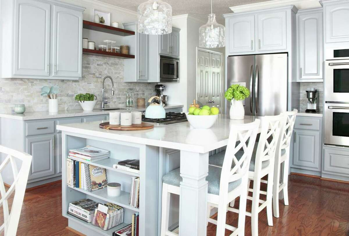 Erin and Aaron Sorrell kitchen in their Katy home got an update with a new island, painted cabinets and new tile and counters.