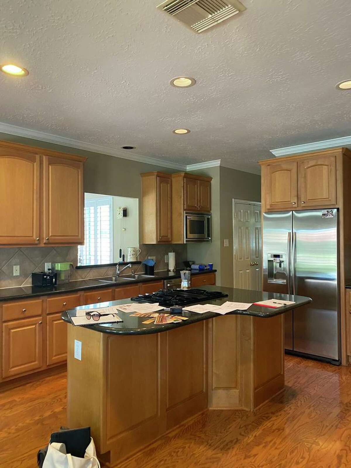 Before, the kitchen had wood-stained cabinets, a dark counter and an irregular-shaped island, common in homes built 20 years ago.