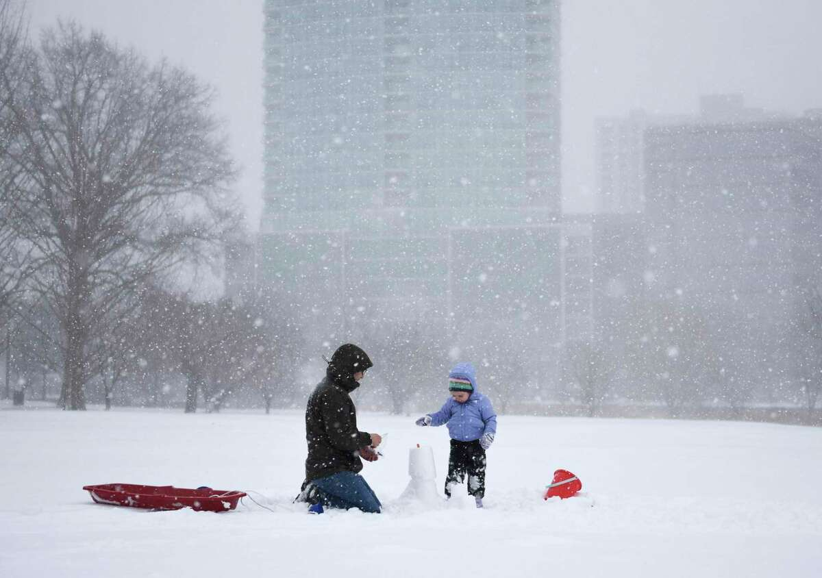 Stamford's Brian Silbert and his daughter, Piper, 3, play in the snow at Mill River Park in Stamford, Conn. Monday, Feb. 1, 2021. The area received consistent light snow starting Sunday evening and continuing throughout the day Monday.